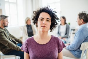 Photo of woman in purple shirt looking at camera during DBT skills class at Balance and Potential Therapy in Alpharetta, GA