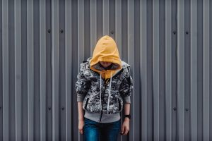 Teen boy in hoodie looking at the ground | Comprehensive DBT Program for Adults and Teens | DBT for Borderline Personality Disorder | Atlanta area - Alpharetta, GA 30022